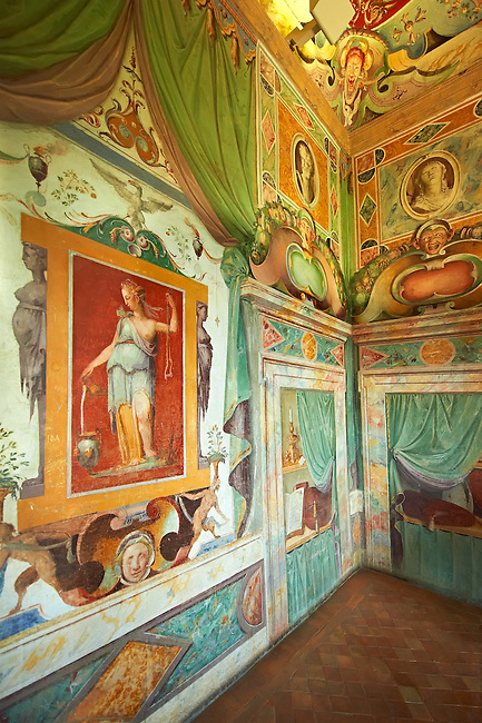 """Room of Glory (Stanza della Gloria ). The Renaissance paintings by Federico Zuccari can be dated to 1566-68. The frescoes in the vaulted ceiling depict the virtues which consent the fulfilment of """"Glory"""" with allegorical panels depicting Magnanimity, Fortune, Time and Religion. Trompe-l'?il alcoves reveal the Cardinals hat of Ippolito d'Este  . Villa d'Este, Tivoli, Italy. A UNESCO World Heritage Site."""
