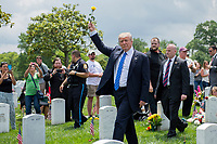 President Donald J. Trump raises a yellow rose to families of fallen service members at Arlington National Cemetery Memorial Day May 29, 2017. Trump greeted and spoke with family members of fallen service members in the cemetery's Section 60. (DoD photo by EJ Hersom)