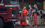10 March 2015, Kandy, Sri Lanka:  A Buddhist monk waits for a bus with tourists indowntown Kandy, Sri Lanka. Picture by Graham Crouch?The Australian Magazine