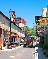 Ripley's Red Train makes it way down Aviles Street's narrow cobblestone road in downtown St. Augustine, Florida. Aviles Street is the nation's oldest platted street.