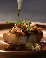 """Melbourne, July 13, 2018 - The dish of <br /> """"Wild barramundi, porcini mushroom & fennel fondue, Champagne jus"""" at the Pommery Champagne Dinner at Philippe Restaurant in Melbourne, Australia. Photo Sydney Low"""