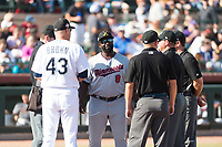 Salt River Rafters manager Tommy Watkins (8), of the Minnesota Twins organization, meets with Peoria Javelinas manager Daren Brown (43) and umpires John Bacon, Dan Merzel, Jeremy Riggs, and Bryan Fields before the Arizona Fall League Championship game against the Peoria Javelinas at Scottsdale Stadium on November 17, 2018 in Scottsdale, Arizona. Peoria defeated Salt River 3-2 in extra innings. (Zachary Lucy/Four Seam Images)
