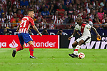 Atletico de Madrid's Lucas Hernandez and Rayo Vallecano's Gael Romeo Kakuta during La Liga match. August 25, 2018. (ALTERPHOTOS/A. Perez Meca)