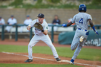 Pulaski Yankees first baseman Jake Farrell (72) waits for a throw as Diego Hernandez (4) of the Burlington Royals hustles down the line at Calfee Park on September 1, 2019 in Pulaski, Virginia. The Royals defeated the Yankees 5-4 in 17 innings. (Brian Westerholt/Four Seam Images)