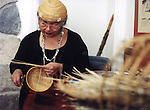 Hupa basket weaver weaves a basket hat at the Haramokngna American Indian Cultural Center in the Angeles National Forest near Mount Wilson, CA