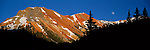 The moon above the Red Mountain in the San Juan Mountains of Colorado.