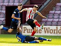 17th July 2021; Tynecastle Park, Edinburgh, Scotland;Pre Season Friendly Football, Heart of Midlothian versus Sunderland; Loïc Damour of Hearts slides in to tackle Lynden Gooch of Sunderland FC