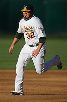 OAKLAND, CA - July 21:  Jack Cust of the Oakland Athletics runs the bases during the game against the Baltimore Orioles at the McAfee Coliseum in Oakland, California on July 21, 2007.  The Athletics defeated the Orioles 4-3.  Photo by Brad Mangin