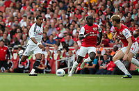 Pictured L-R: Scott Sinclair of Swansea coming up against Bacary Sagna and Per Mertesacker both of Arsenal. Saturday 10 September 2011<br />