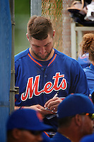 New York Mets outfielder Tim Tebow (15) signs an autograph during an Instructional League game against the Miami Marlins on September 29, 2016 at Port St. Lucie Training Complex in Port St. Lucie, Florida.  (Mike Janes/Four Seam Images)