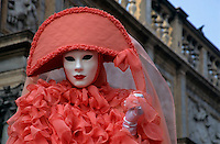 Portrait of a person wearing Venetian masks and costumes, Venice, Italy.