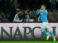 Calcio, Serie A: Napoli vs Juventus. Napoli, stadio San Paolo, 30 marzo 2014. <br /> Napoli forward Dries Mertens, of Belgium, celebrates after scoring during the Italian Serie A football match between Napoli and Juventus at Naples' San Paolo stadium, 30 March 2014. Napoli won 2-0.<br /> UPDATE IMAGES PRESS/Isabella Bonotto