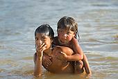 Xingu Indigenous Park, Mato Grosso State, Brazil. Aldeia Afukuri (Kuikuro). Children washing in the river.