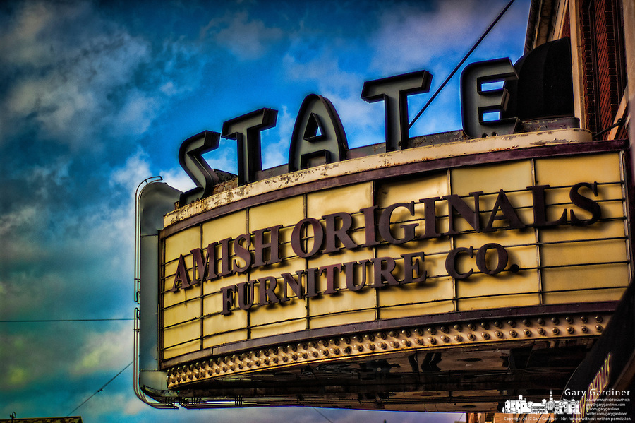 State theater in uptown Westerville with Amish Originals Furniture Company lettering on marquee..
