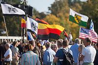 """200 bis 300 Reichsbuerger, Neonazis, Antisemiten und Verschwoerungstheoretiker versammelten sich am 3. Oktober 2014 zu einem """"Sturm auf den Reichstag"""". Die sogenannten Reichsbuerger erkennen die hiesigen Gesetze und Institutionen nicht an. Deutschland sei 1945 nicht befreit sondern besetzt worden und Grenzen des Deutschen Reiches von 1937 wuerden immer noch gelten. Anhaenger dieser Gruppierung fallen immer wieder durch Holocaustleugnung und Volksverhetzung auf.<br /> Zu den Kundgebungsteilnehmern sprach neben bekennenden Rechten auch der deutsche Pop- und Schlagersaenger Xavier Naidoo.<br /> Im Bild: Kundgebungsteilnehmer mit umgedrehter Deutschlandfahne als Zeichen der Ablehnung der Bundesrepublik.<br /> 3.10.2014, Berlin<br /> Copyright: Christian-Ditsch.de<br /> [Inhaltsveraendernde Manipulation des Fotos nur nach ausdruecklicher Genehmigung des Fotografen. Vereinbarungen ueber Abtretung von Persoenlichkeitsrechten/Model Release der abgebildeten Person/Personen liegen nicht vor. NO MODEL RELEASE! Don't publish without copyright Christian-Ditsch.de, Veroeffentlichung nur mit Fotografennennung, sowie gegen Honorar, MwSt. und Beleg. Konto: I N G - D i B a, IBAN DE58500105175400192269, BIC INGDDEFFXXX, Kontakt: post@christian-ditsch.de<br /> Urhebervermerk wird gemaess Paragraph 13 UHG verlangt.]"""