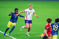 ORLANDO, FL - JANUARY 18: Lindsey Horan #9 of the USWNT dribbles the ball during a game between Colombia and USWNT at Exploria Stadium on January 18, 2021 in Orlando, Florida.