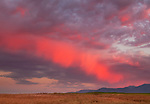 "A rare ""painted sky"" with shades of crimson in the clouds over the Talent hills"