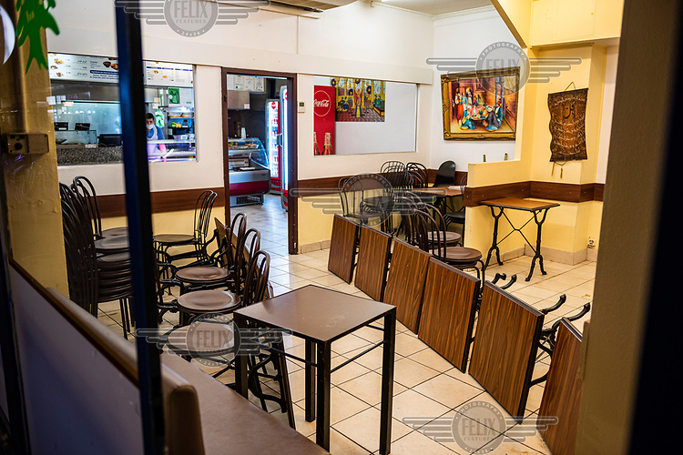 A Lebanese kebab restaurant in Geneva's multi-cultural Paquis district which has converted its dining room into an entry corridor for take away customers during the second wave of the COVID-19 pandemic which saw eat-in restaurants and non-essential shops forced to close.