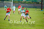 Ballyduff's Paud Costello been chased by Darragh Scanlon of St Michaels Foilmore in the County Senior football league.