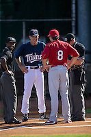 Elizabethton Twins manager Ray Smith (2) meets with Johnson City Cardinals manager Chris Swauger (8) prior to their Appalachian League game at Joe O'Brien Field on July 11, 2015 in Elizabethton, Tennessee.  The Twins defeated the Cardinals 5-1. (Brian Westerholt/Four Seam Images)