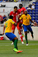 Harrison, NJ - Friday July 07, 2017: Steven Vitoria, Alphonso Davies, Cedric Fabien during a 2017 CONCACAF Gold Cup Group A match between the men's national teams of French Guiana (GUF) and Canada (CAN) at Red Bull Arena.