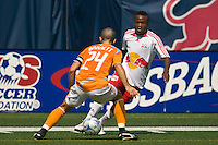 New York Red Bulls midfielder Dane Richards (19) is marked by Houston Dynamo defender Wade Barrett (24). The New York Red Bulls defeated the Houston Dynamo 3-0 during a Major League Soccer match at Giants Stadium in East Rutherford, NJ, on August 24, 2008.