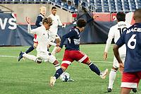 FOXBOROUGH, MA - OCTOBER 09: Felipe Valencia #28 of Fort Lauderdale CF passes the ball as Ryan Spaulding #34 of New England Revolution II tries to intercept during a game between Fort Lauderdale CF and New England Revolution II at Gillette Stadium on October 09, 2020 in Foxborough, Massachusetts.