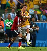 Mario Yepes of Colombia and David Luiz of Brazil collide
