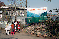 A large sign promoting environmental awareness stands in rubble in the center of  Srinagar, Kashmir, India. © Fredrik Naumann/Felix Features