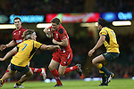 Wales replacement outside half Rhys Priestland steps inside Australia flanker Michael Hooper.<br /> Dove Men Series 2014<br /> Wales v Australia<br /> Millennium Stadium<br /> 08.11.14<br /> ©Steve Pope-SPORTINGWALES