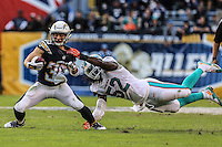 Dec. 20, 2015. San Diego,  CA. USA.|Danny Woodhead catches a pass as thr Dolphins Kevin Sheppard tries to make the tackle during the Chargers vs Dolphins game at the Q. |Photos by Jamie Scott Lytle. Copyright.