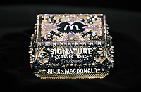 "Pictured: The new McDonalds burger box designed by Julien Macdonald at the Fabian Way restaurant in Swansea, Wales, UK. Wednesday 30 August 2017<br /> Re: McDonalds UK has revealed it has paired up with fashion industry icon, Julien Macdonald OBE to unveil his interpretation of a luxe burger box for McDonald's Signature Collection, its popular range of gourmet burgers.<br /> Julien Macdonald OBE was commissioned to bring his undeniably glamourous aesthetic, to combine fashion and food's finest. Julien's unique red carpet gowns and embellished styles have cemented him as a go-to brand for A-list international talent who are often praised for their stylish choices.<br /> Julien will unveil his creation for The Signature Collections - which is the embodiment of pure luxury and features crystal detailing, embellishment and bespoke digital print, along with McDonald's iconic Golden Arches - at a Signature Collection premiere event in its flagship Leicester Square restaurant.<br />  ""I drew inspiration from my fashion creations and iconic embellished red carpet dresses. This was translated into a gold baroque crystal encrusted box, which is the perfect packaging for the luxury McDonald's Signature Collection burger,"" commented Julien.<br />  The Signature Collection has been on trial in selected restaurants, and following great customer response, will now be available in over 900 McDonald's restaurants across the UK by year-end."
