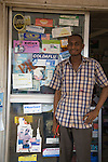 A Proprietary Patent Medicine Vendor (PPMV) stands in front of his shop in the Garki area of Abuja, Nigeria.