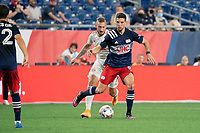 FOXBOROUGH, MA - MAY 22: Matt Polster #8 of New England Revolution passes the ball under pressure from Daniel Royer #77 of New York Red Bulls during a game between New York Red Bulls and New England Revolution at Gillette Stadium on May 22, 2021 in Foxborough, Massachusetts.