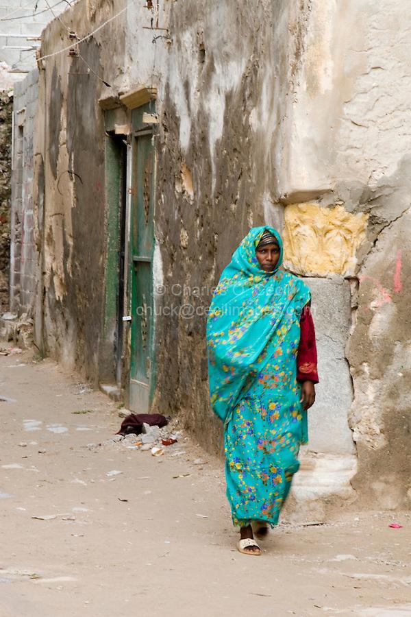 Tripoli, Libya - African Immigrant Walking in Medina Street.  Many sub-Saharan immigrants live in Tripoli's medina.