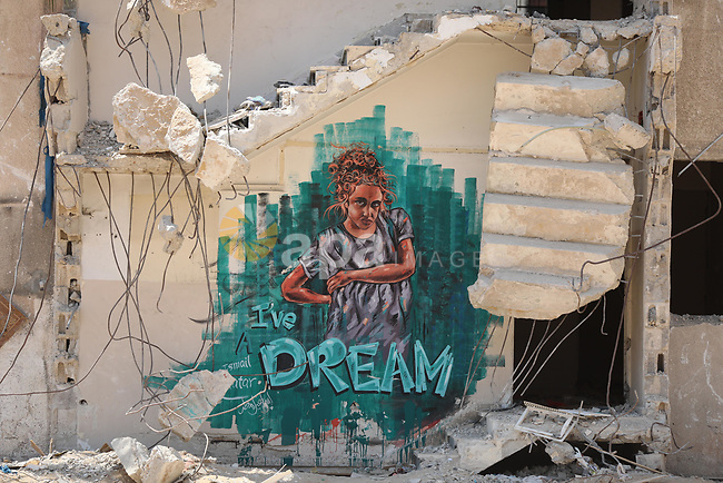 A mural is displayed on a wall of a destroyed house which was destroyed by airstrikes during an 11-day war between Hamas and Israel last May in Gaza city on August 7, 2021. Al-Sisi also promised $500 million for rebuilding Gaza, and gave directives to Egyptian state institutions to provide all that is needed to accelerate reconstruction and completion. Photo by Ashraf Amra