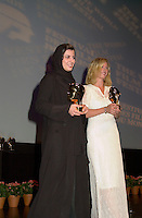 Sept 2, 2002, Montreal, Quebec, Canada<br /> <br /> Leila Hatami (L) and Maria Bonnevie (R) receive the <br /> Best Actress award ,at the closing ceremony of the 2002 Montreal World Films Festival, Sept 2 2002, in  Montreal, Quebec, Canada<br /> <br /> <br /> Mandatory Credit: Photo by Pierre Roussel- Images Distribution. (©) Copyright 2002 by Pierre Roussel <br /> <br /> NOTE : <br />  Nikon D-1 jpeg opened with Qimage icc profile, saved in Adobe 1998 RGB<br /> .Uncompressed  Uncropped  Original  size  file availble on request.