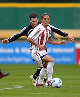 2006 MLS Regular Season Match at RFK Stadium,Chivas USA midfielder Juan Francisco Palencia fighting for control of the ball against midfielder Ben Olsen,   final score DC United 2  , Chivas USA  0 , Saturday, April 8.