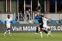 SAN JOSE, CA - SEPTEMBER 16: Andy Rios #25 of the San Jose Earthquakes is defended by Andy Polo #7 of the Portland Timbers during a game between Portland Timbers and San Jose Earthquakes at Earthquakes Stadium on September 16, 2020 in San Jose, California.