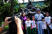 Young children pose next to the Memorare Statue, dedicated to the victims of 1945 war in the walled city of Intramuros in Manila, Philippines. Photo: Sanjit Das