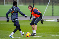 Tuesday 17 January 2017<br /> Pictured: ( L-R ) Nathan Dyer and Angel Rangel during training <br /> Re:Swansea City training session at the Fairwood Training ground, Fairwood, Swansea, Wales, UK
