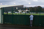 A Bradford Park Avenue fan outside Horsfall Stadium watching through the fence, as their team lose 1-2 to Telford United in the National League North, 21st November 2020. The match was played behind closed doors, due to the second Coronavirus lockdown.