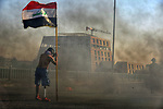 An Iraqi protester holds flag as he takes part in an anti-government demonstration and they refused to assign Muhammad Tawfiq Allawi as prime minister and the Representatives parliament failed to hold the emergency session in Iraq's southern city of Nasiriyah in Dhi Qar province, on March 1, 2020. Photo by Wadaa al-Aumry