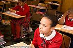 K-8 Parochial School Bronx New York Grade 4 girl listening in class horizontal