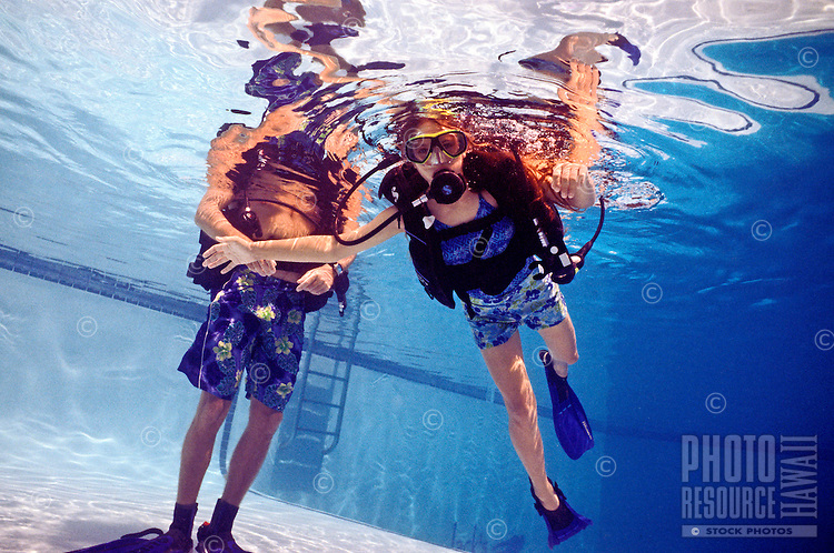 A young woman learns to scuba dive in a pool on the Big Island of Hawaii.