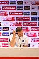 Wayne Rooney of England looks dejected during his press conference