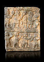 Pictures & images of the South Gate Hittite sculpture stele depicting Hittite Gods. 8th century BC. Karatepe Aslantas Open-Air Museum (Karatepe-Aslantaş Açık Hava Müzesi), Osmaniye Province, Turkey. Against black background