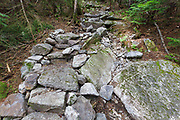 July 2012 - Less than two months after being built, this length of staircase along the Mt Tecumseh Trail in the New Hampshire White Mountains looked to be falling apart. In August 2012, the stones were re-positioned and removed from the footbed of the staircase.