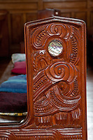 Cultural Syncretism.  Pew carved in Maori style, St. Mary's Anglican Church, Tikitiki, north island, New Zealand, built 1924-26 as a memorial to Maori soldiers who fought and died in World War I.   A member of the New Zealand Historic Places Trust.  Highway 35, Gisborne Region.