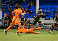 LAKE BUENA VISTA, FL - JULY 18: Eryk Williamson #30 of the Portland Timbers is tripped up as he tries to dribble past a sliding opponent during a game between Houston Dynamo and Portland Timbers at ESPN Wide World of Sports on July 18, 2020 in Lake Buena Vista, Florida.